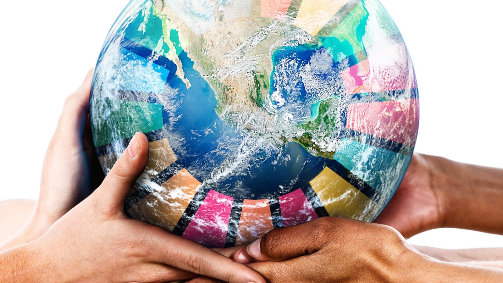 Agenda 2030 glob bärs av händer