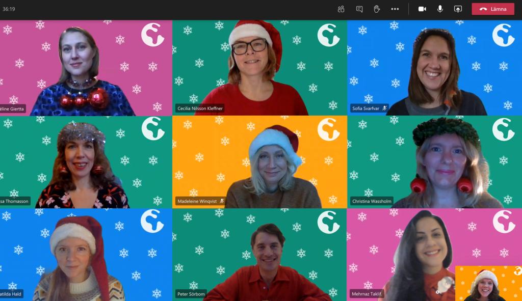 Kanslipersonalen i digitalt julkort, med pyntig utstyrsel och bakgrun
